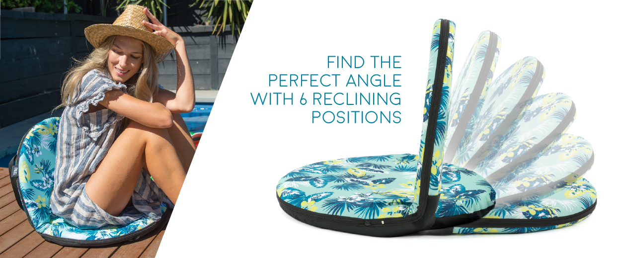 A woman soaks up the sun on a tropical print cushion recliner chair. The multiple recliner angles of the travel seat are shown on another cushion recliner. The text reads find the perfect angle with 6 reclining positions.