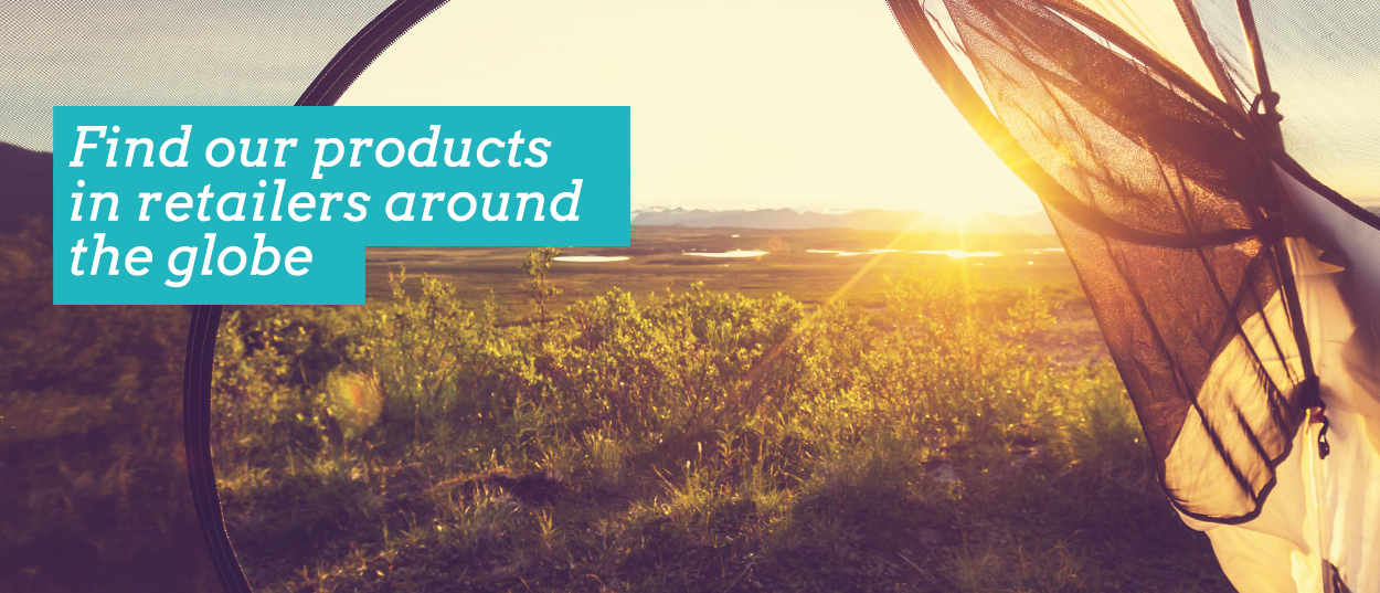 Find our (SlumberTrek) products in retailers around the globe. Image shows sunrise through an open camping tent door.